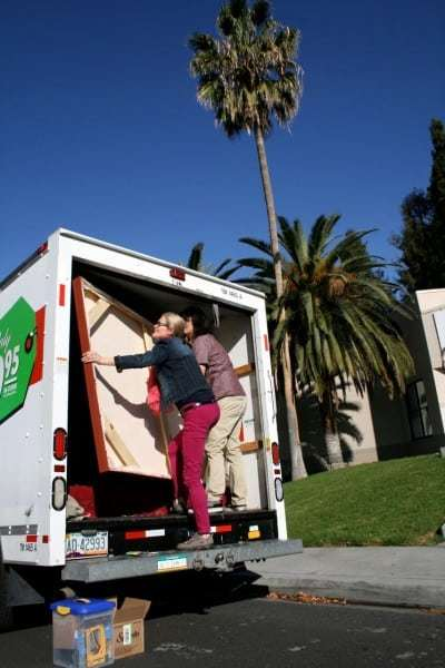 Photo unloading paintings from truck