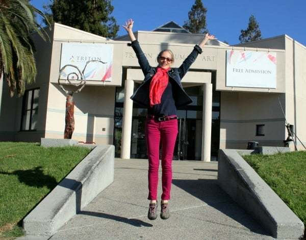 Feeling gleeful after all paintings were unloaded and delivered unharmed to the Triton Museum of Art. Photo by Marie Cameron.