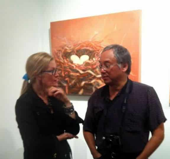 DeWitt Cheng and Holly Van Hart at Sandra Lee Gallery reception, in front of Holly's painting 'Opportunity'