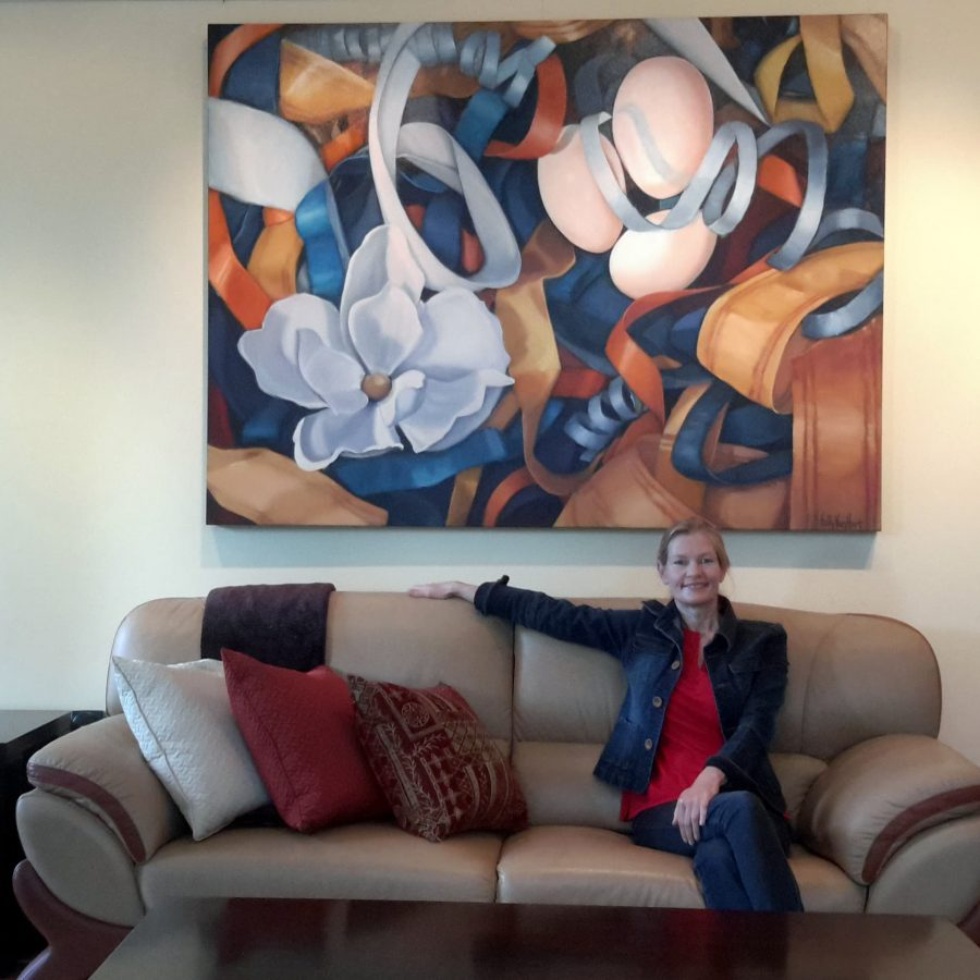 """Holly Van Hart taking a break from preparing for the Open Studio event, May 2015. Behind me is my painting """"Posh"""""""
