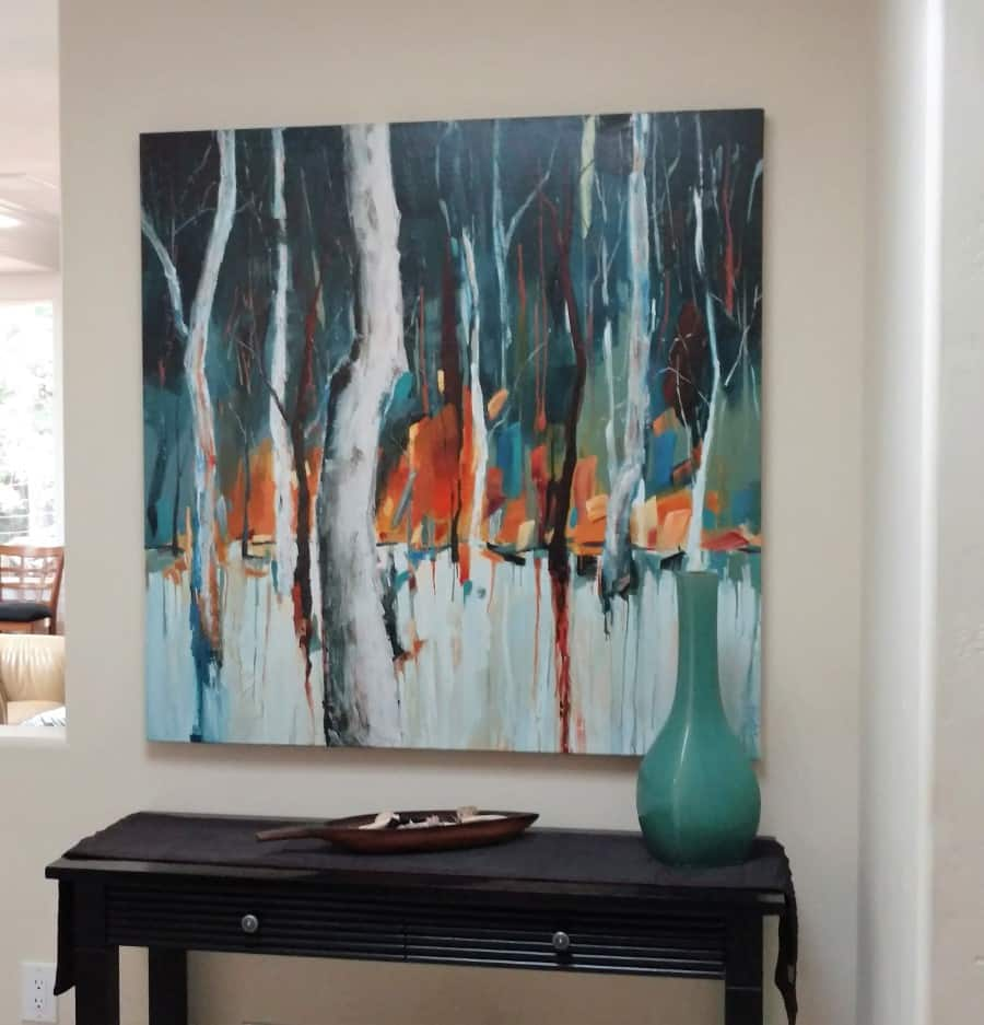 landscape forest trees | blue white orange red brown | Installed painting by Holly Van Hart | As featured in the Huffington Post and Professional Artist Magazine